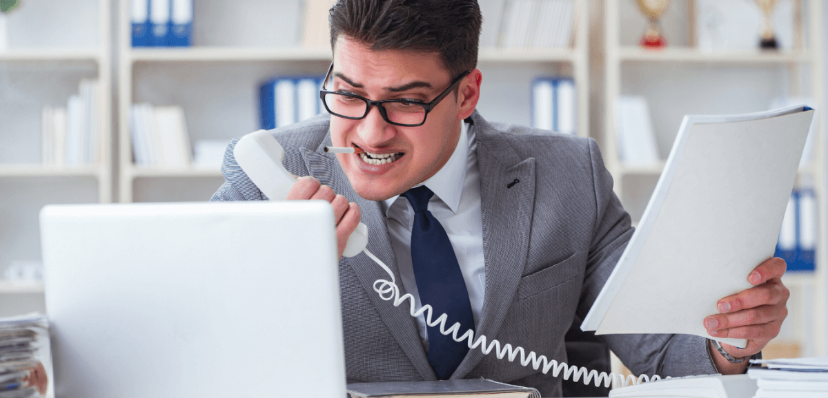 angry man on phone dealing with employee turnover